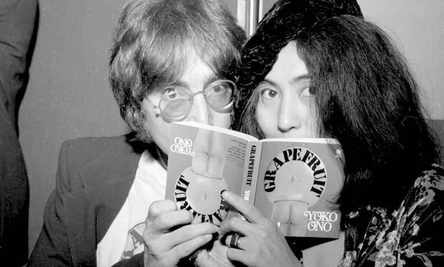 John and Yoko reading